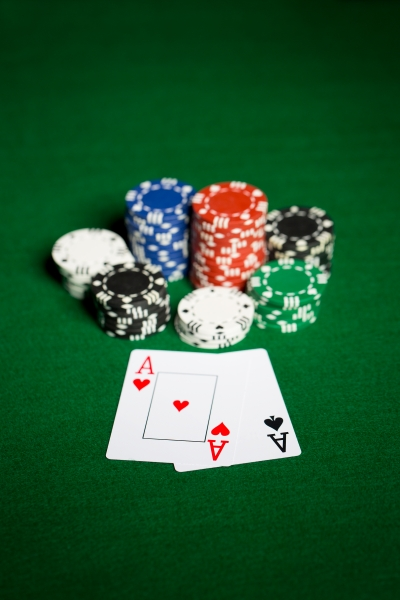 10693868-close-up-of-casino-chips-and-playing-cards